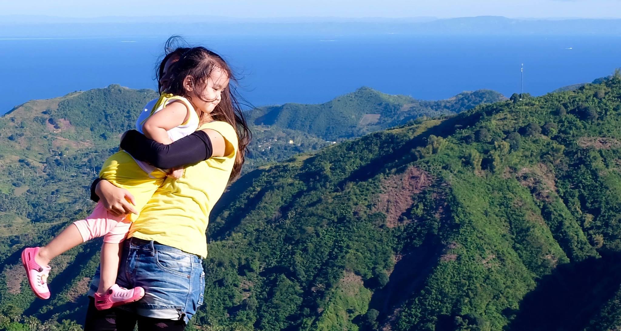 a kid enjoys a hike at Mt. Naupa